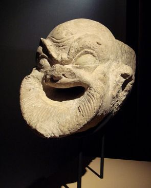 First century, Hellenistic gargoyle representing a comical cook slave from Al Khanoum, Afghanistsan. Guimet Museum. Personal photograph 2006. Commons