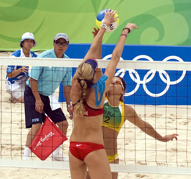 Semi final of Women's beach volleyball at the Beijing Olympics. Author Craig Maccubin. Commons