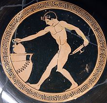 Boy  drawing wine from a crater. His nudity shows that heis serving as a cup bearer at a symposium or banquet.at a Greek symposium or banquet (