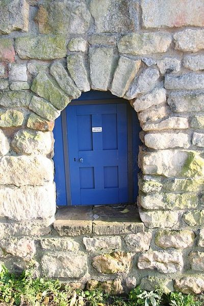 Diminutive doorway. A tiny doorway, 18inches high, in an ancient wall on Motherby Hill. The notice on the door says: