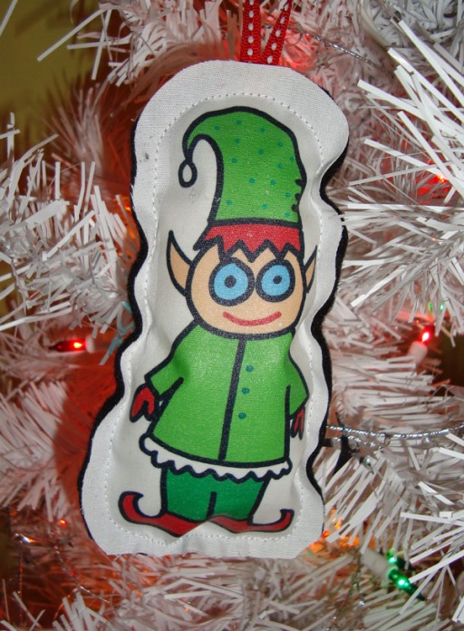A diminutive Christmas elf on a Christmas tree decoration. Originally posted on Flickr. Author: Jolene Morris. Commons