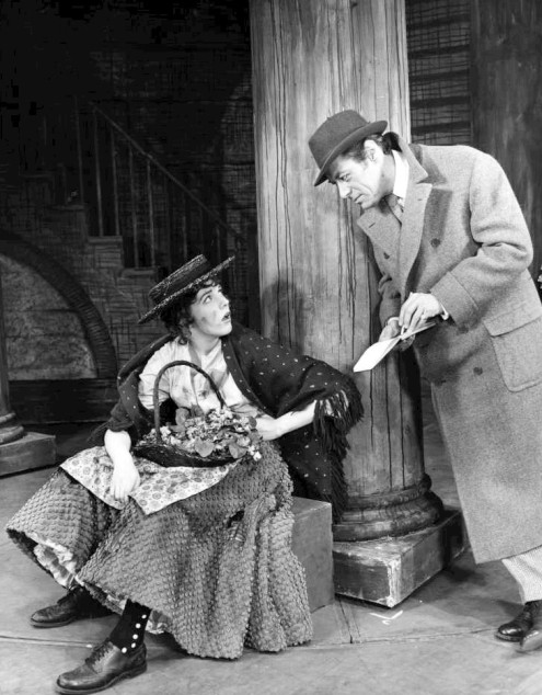 Julie Andrews and Rex Harrison from My Fair Lady. Flower girl, Eliza meets Professor Henry Higgins.