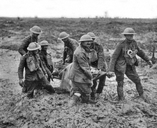 Stretcher bearers at the Battle of Passchendale. August 1917. Author: John Warwick Brooke. Public Domain.