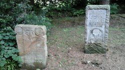 Two of the altar stones outside the temple. Several more are located around the Vindolanda site