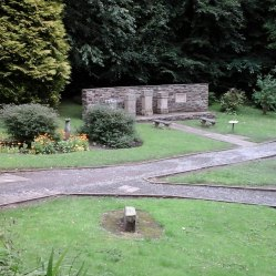 Gardens where altars have been placed against a wall.