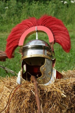 Reconstruction of a centurion helmet with crest made of hair moss. Photographed from a show of Legio XV from Pram, Austria, No details about author. Creative Commons