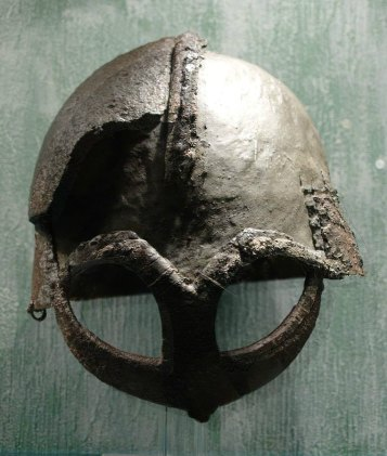 Viking helmet from Gjermundbufunnet, now at Kulturhistorisk museum. Author: J Jeblad. Creative Commons