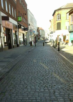 Strret leading to the Market Square with old-style cobbles