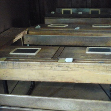 Row of Double Desks in Victorian Classroom
