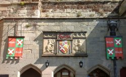 Coats of arms decorating the curtain wall close to the main entrance
