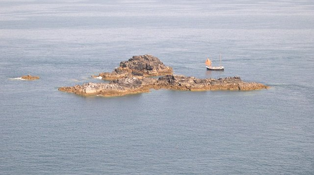 The Carracks, a group of offshore rocky islands, known locally as Seal Island. The boat is probably one of the regular tourist trips from St. Ives. From geograph.org.uk. Author: Tony Atkin Creative Commons