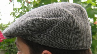 Flat cap, side view. Photographed by Heron. Creative Commons