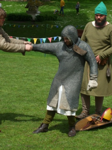 Garbing the knight in his chain mail armour.