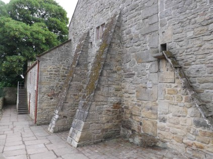 Buttresses on the strong house