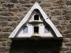 Dovecote on the side wall of Pockington Old Hall