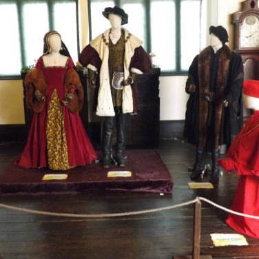 Henry, Ann and Cardinal Wolsey in red