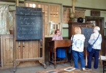 Teacher and blackboard in the village school classroom