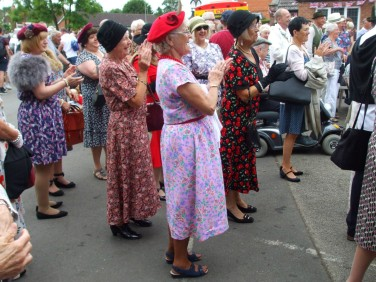 A group of older women appreciate the Glenn Miller music and dancing.