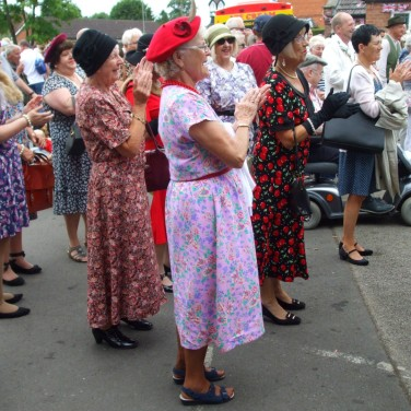 A group of older women appreciate the Glenn Miller music and dancing.