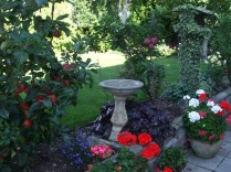 Bird bath and flower beds