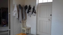 Hooks outside the schoolroom for children's bags aprons etc.