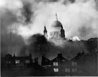 Air raid damage in London during the Second World War. St. Paul's Cathedral rising above the bombed London skyline. Photo taken from the roof of the Daily Mail offices in Fleet Street. Author: Mason, Herbert, Daily Mail photo. Public Domain'