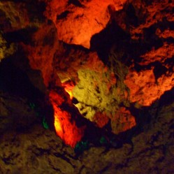 Great chamber, so big and dark, is illuminated wit coloured lights