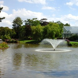 Fountain and lake with the Victorian conservatory behind